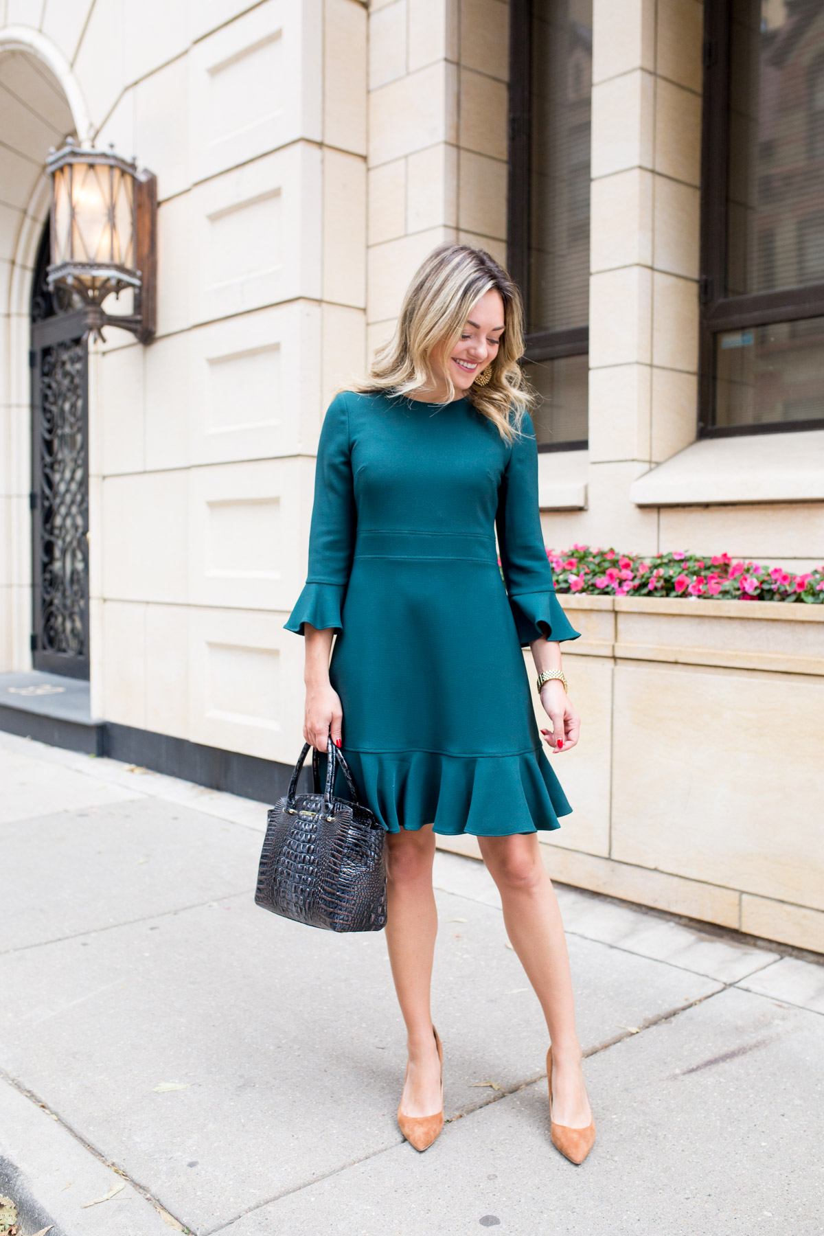 Chicago beauty blogger Jessica Sturdy wearing a green ruffle dress for work.