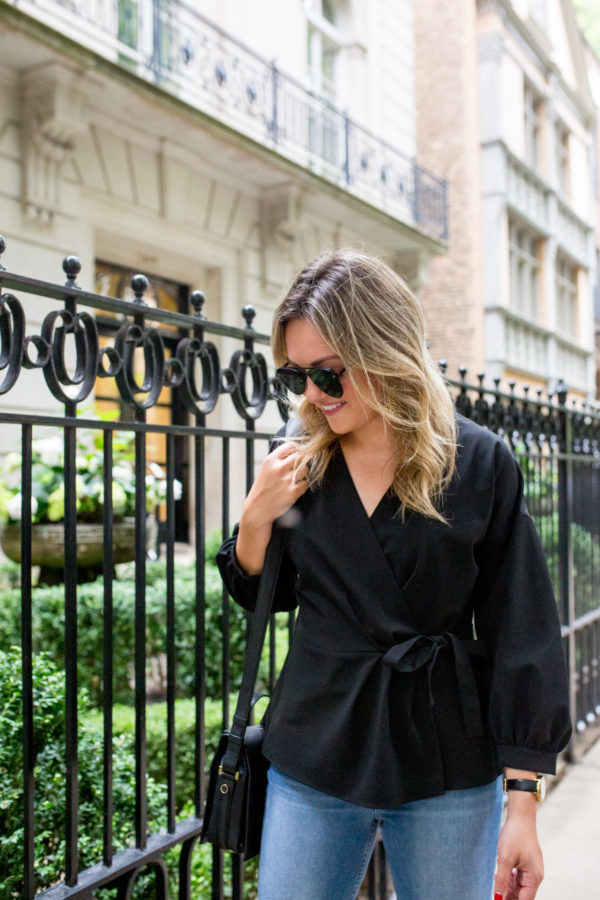 Chicago blogger styling a black wrap top for the office.