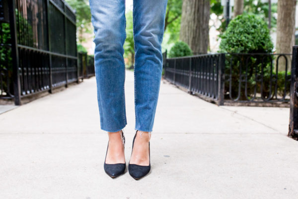 Bows & Sequins wearing Paige straight leg jeans with black pointed toe pumps.