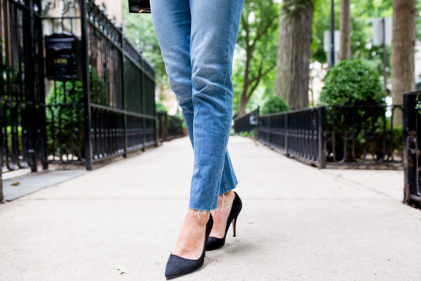 Bows & Sequins wearing Paige raw hem jeans with Kate Spade black suede licorice pumps.