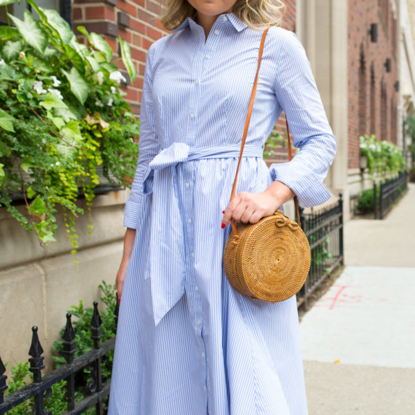 Jessica Sturdy wearing a shirt dress with a round circle rattan wicker bag.