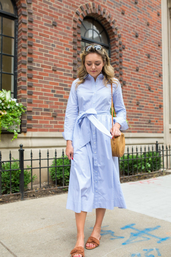 Jessica Sturdy wearing a blue and white midi dress with long sleeves an a collar.