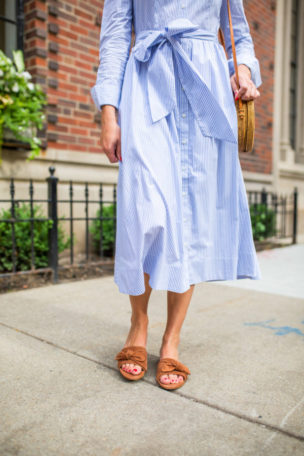 Jessica Sturdy wearing M.Gemi sandals and a midi dress.