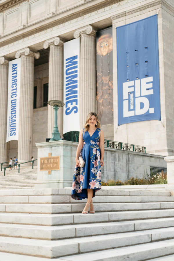 Jessica Sturdy wearing a formal floral Eliza J dress in front of the Field Museum in Chicago.