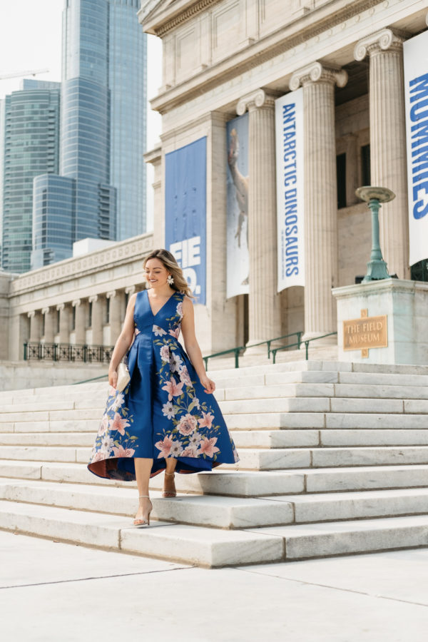Top Chicago fashion blogger Jessica Sturdy wearing a floral blue Eliza J dress from Nordstrom in front of Chicago's Field Museum for a black tie optional wedding.