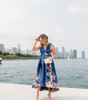 Chicago fashion blogger Jessica Sturdy wearing a black tie wedding guest dress in one of the most photogenic spots in the city.