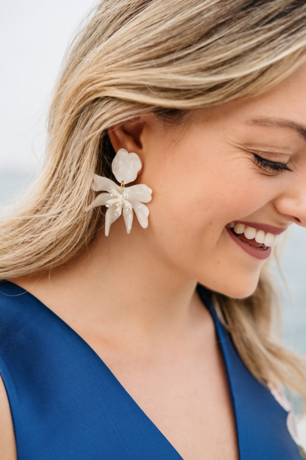 Bows & Sequins wearing white daffodil earrings from Nordstrom by Lele Sadoughi.