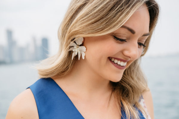 Blogger Bows & Sequins wearing white flower earrings by Lele Sadoughi.