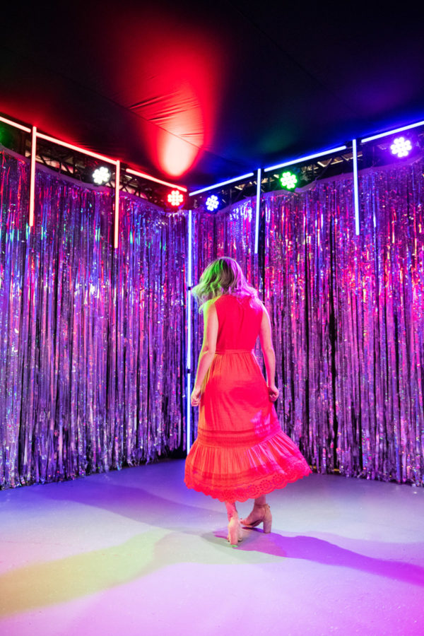 Chicago blogger Bows & Sequins wearing an eyelet dress in a metallic disco room at Happy Place