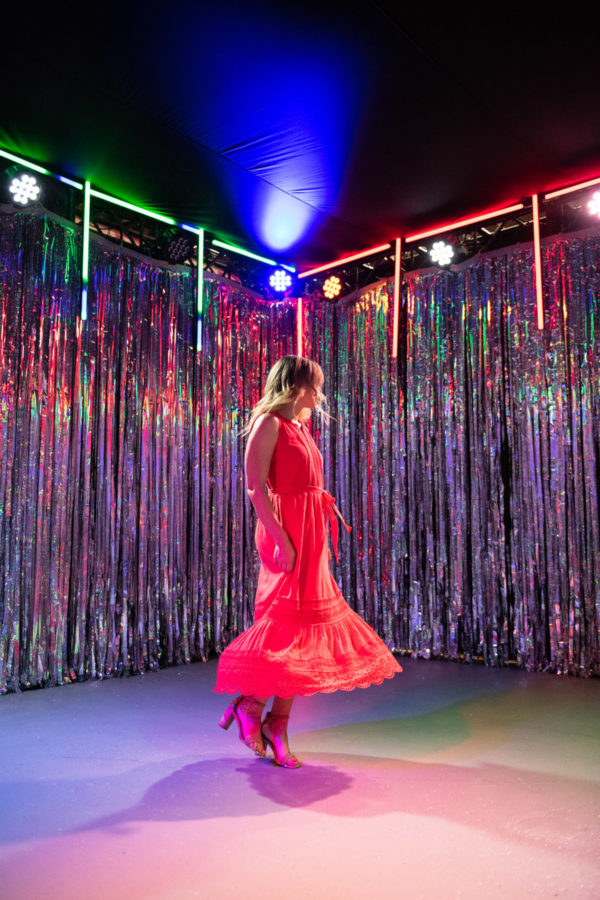 Chicago fashion blogger Jessica Sturdy wearing a red maxi dress in a disco room at Happy Place