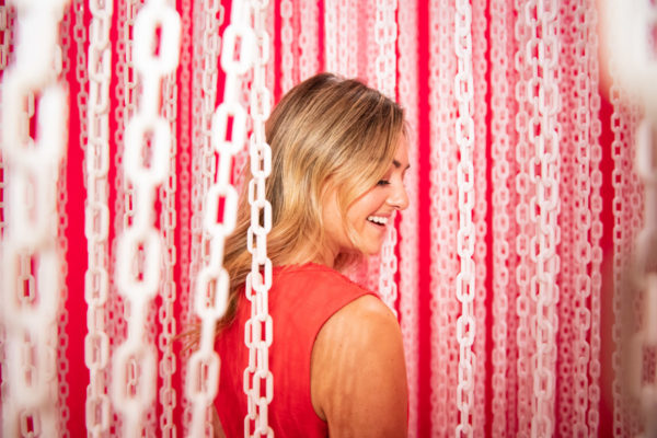 Chicago beauty blogger Jessica Sturdy at Happy Place Chicago in the pink and white chain room.