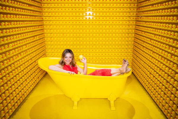 Jessica Sturdy, Chicago-based fashion and travel blogger, at Happy Place in the yellow bathtub.