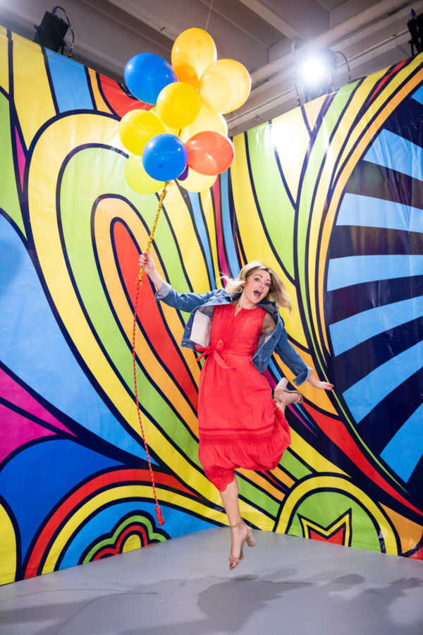 Chicago travel blogger Jessica Sturdy jumping with balloons at Happy Place in Chicago.