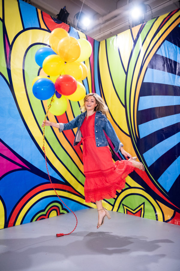 Chicago blogger Jessica Sturdy at Happy Place with red, blue, and yellow balloons.