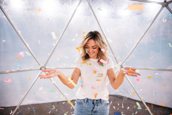 Chicago fashion blogger Jessica Sturdy wearing a Mott & Bow tee shirt at Happy Place throwing confetti.