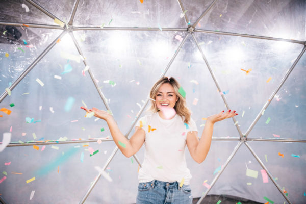 Chicago lifestyle blogger Bows & Sequins throwing paper confetti at Happy Place