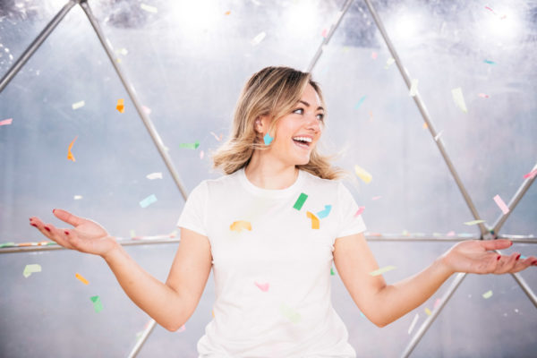 Chicago blogger Jessica Sturdy throwing confetti at Happy Place.