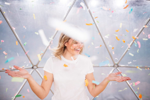 Chicago fashion blogger Jessica Sturdy at Happy Place in the confetti snow globe.
