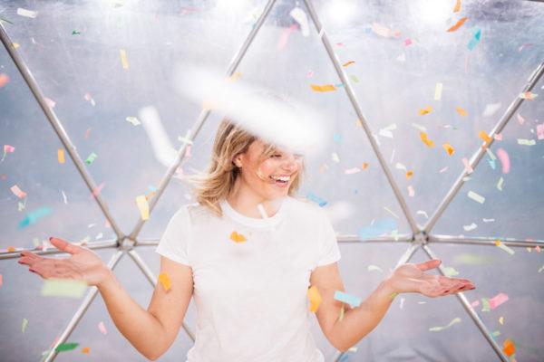 Chicago fashion blogger Jessica Sturdy at Happy Place in the confetti snow globe.