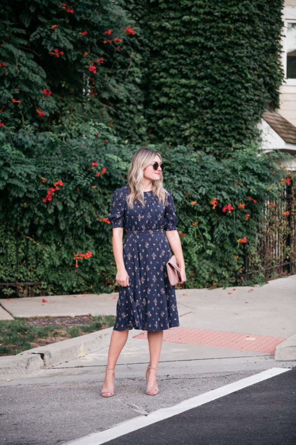 Lifestyle blogger Jessica Sturdy wearing a floral midi dress with sleeves from Nordstrom.