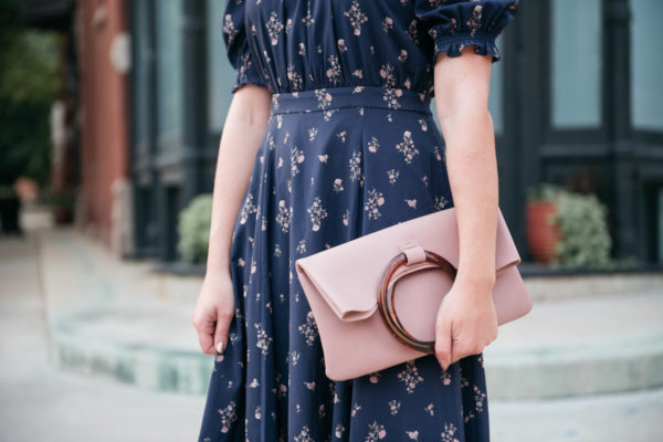 Bows & Sequins wearing the Gal Meets Glam Emily dress with a Topshop Cookie Foldover Clutch.