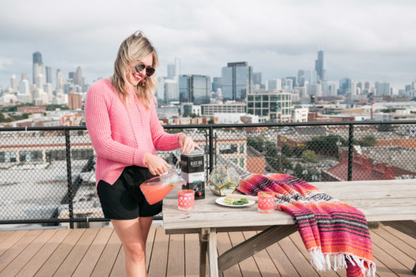 Chicago lifestyle blogger Jessica Sturdy shares a recipe for a Spicy Watermelon Margarita on a Chicago rooftop.