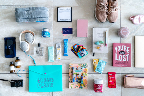 Travel blogger Jessica Sturdy of Bows & Sequins shares what she packed for her 4 month trip with Remote Year. An Ostrich Pillow, Mophie Powerstation XXL, La Mer, Vital Proteins, RXBars, and lots of other health, wellness, and mindfulness items.