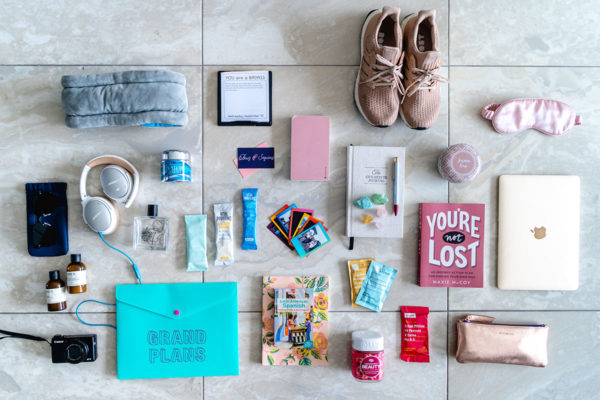Chicago lifestyle blogger, Jessica Sturdy of Bows & Sequins, shares what she packed to go on Remote Year. Some of her favorite health and wellness items include Vital Proteins collagen, Olly vitamins, RXBars, the 5 Minute Journal, You are a Badass daily calendar by Jen Sincero, the Ostrich Pillow, La Mer face creme, and more.