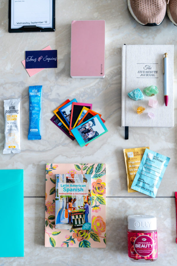 Jessica Sturdy shares a peek inside her suitcase for Remote Year! There's a Spanish dictionary, Vital Proteins collagen peptide, RXBars and almond butter, mini polaroids from friends back home, and even a few crystals.