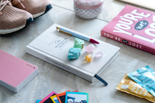 Jessica Sturdy shares her most mindful items to stay centered and focused on wellness while on the road. The 5 Minute Journal is a must both at home and on the road!