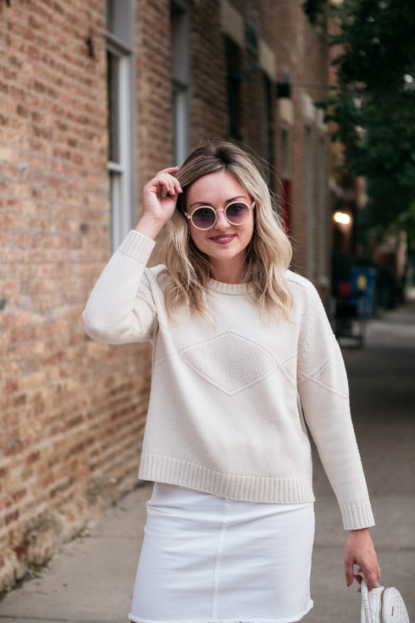 Chicago blogger Bows & Sequins styling a denim skirt for fall.