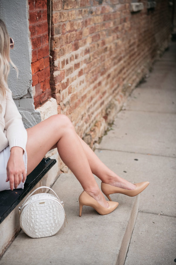 Chicago fashion blogger Bows & Sequins styling a white denim skirt for a cute fall outfit.