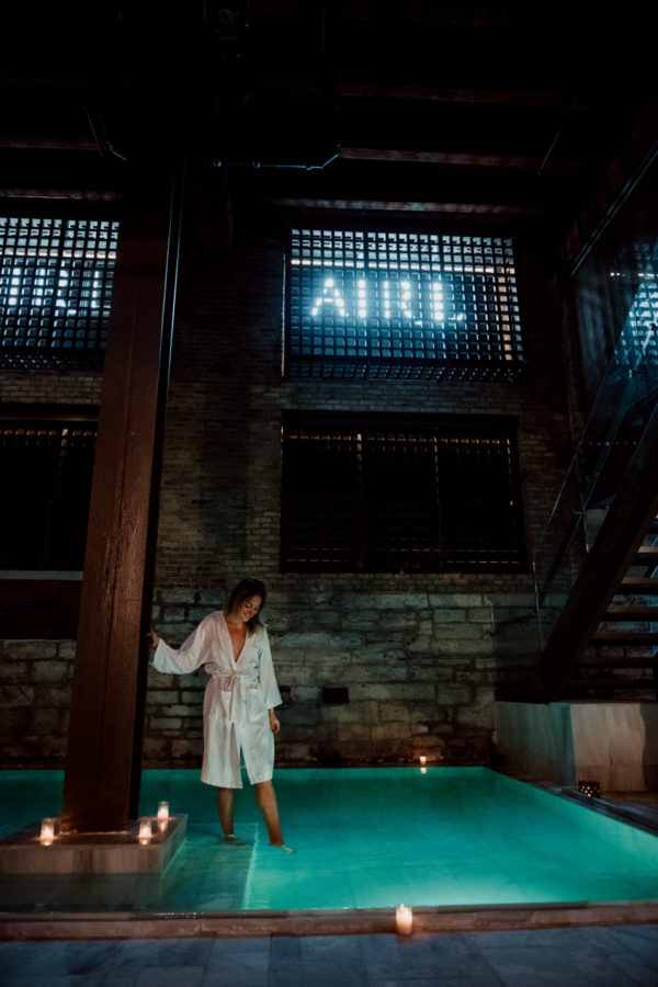 Travel instagrammer Jessica Sturdy at AIRE Ancient Baths in Chicago wearing a white robe.