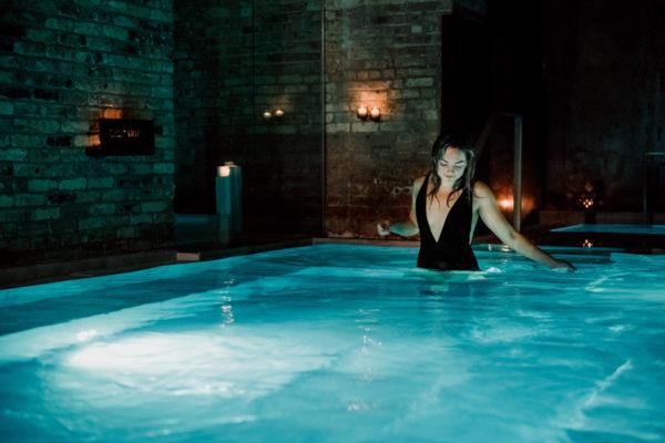 Bows & Sequins at AIRE Ancient Baths in the Caldarium hot bath.