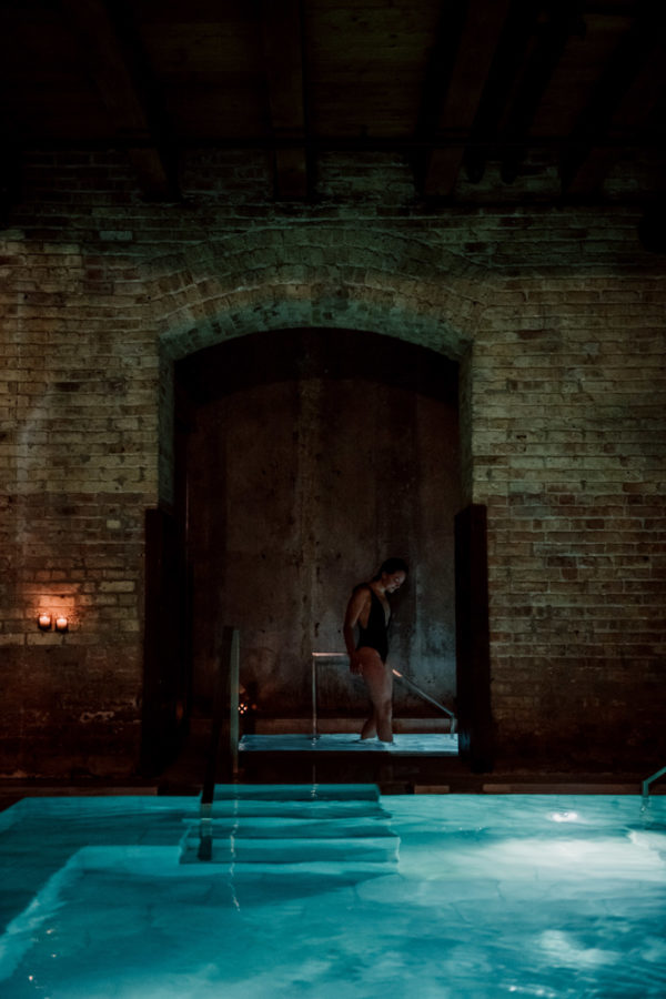 Chicago fashion blogger Bows & Sequins in the cold plunge pool at AIRE Ancient Baths.