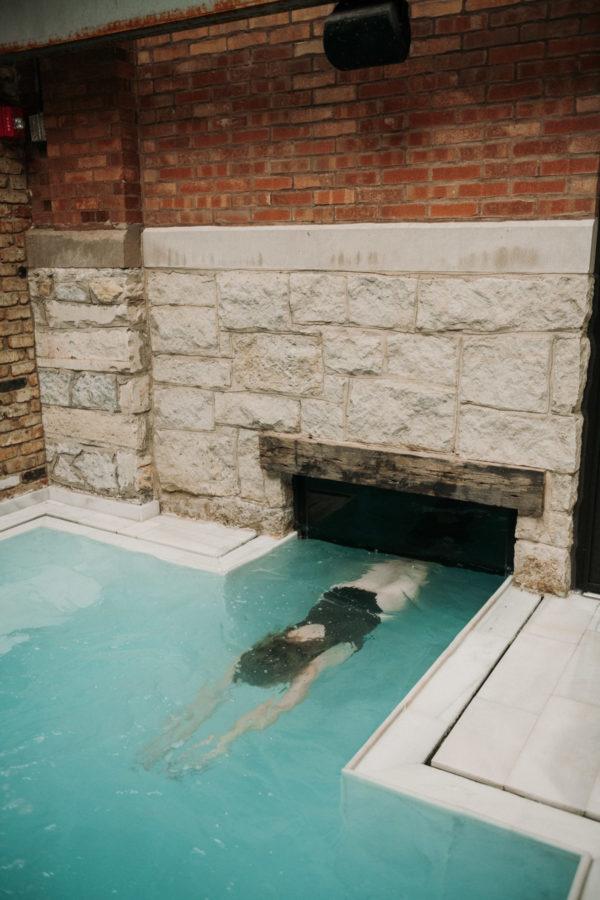 AIRE Ancient Baths Chicago indoor outdoor swim-under pool.