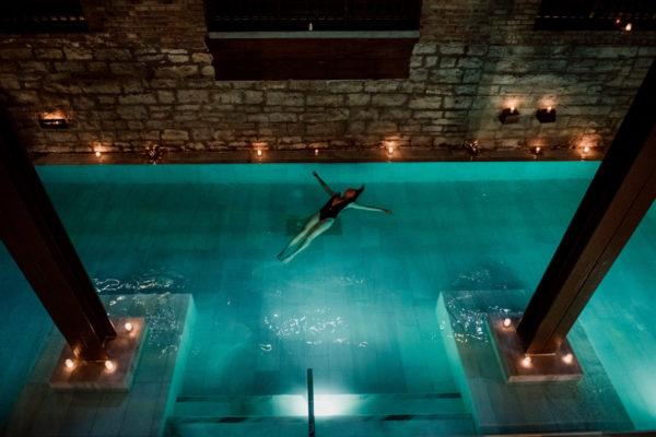 A girl floating in the Flotarium salt bath.