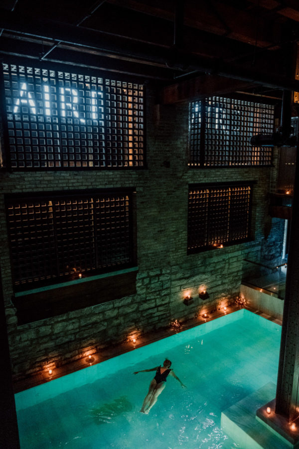 Lifestyle blogger Bows & Sequins floating at AIRE Ancient Baths in Chicago.