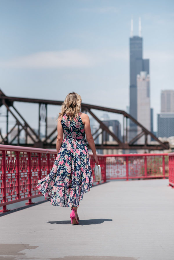 Chicago style blogger wearing a pink and navy floral dress.