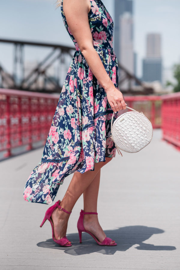 Chicago style blogger Bows & Sequins wearing a high-low hem floral dress.