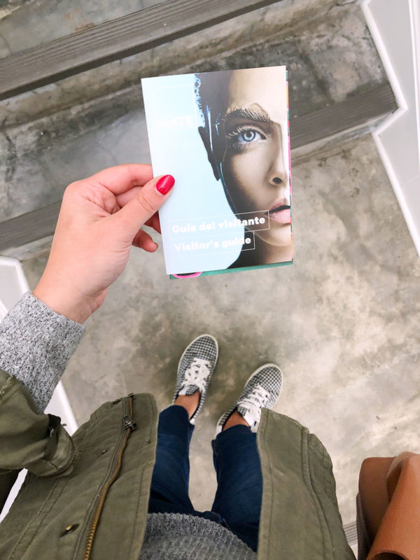 Travel blogger Bows & Sequins at Mario Testino's MATE Museum in the Barranco neighborhood of Lima, Peru. Jessica is wearing gingham sneakers, cropped jeans, and an olive green jacket.