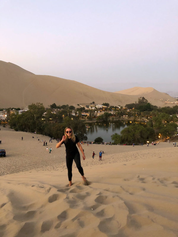 Remote Year travel blogger Jessica Sturdy of Bows & Sequins at the desert oasis of Huacachina in Peru.