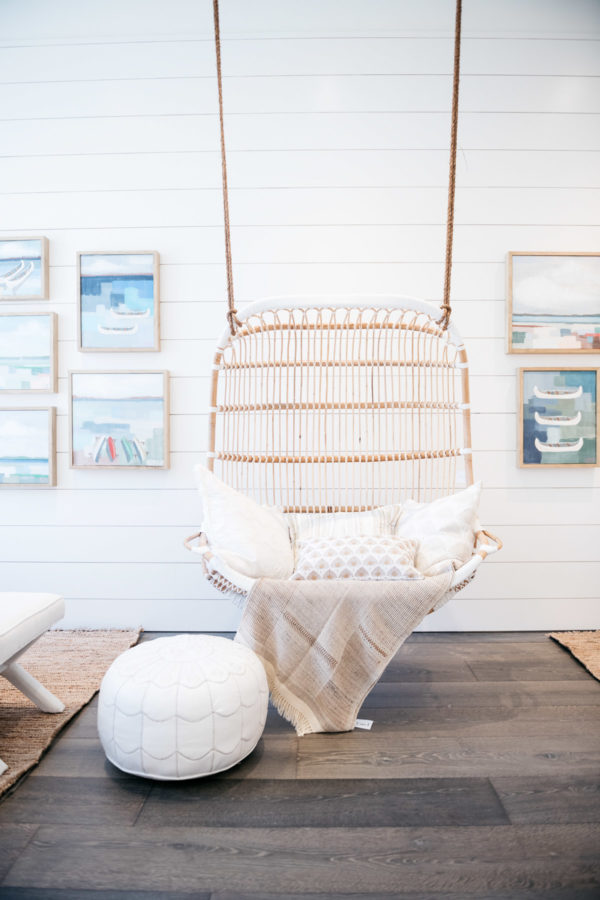 Lifestyle blog Bows & Sequins shares a photo of the hanging wicker swing and gallery wall at Serena & Lily in Chicago.