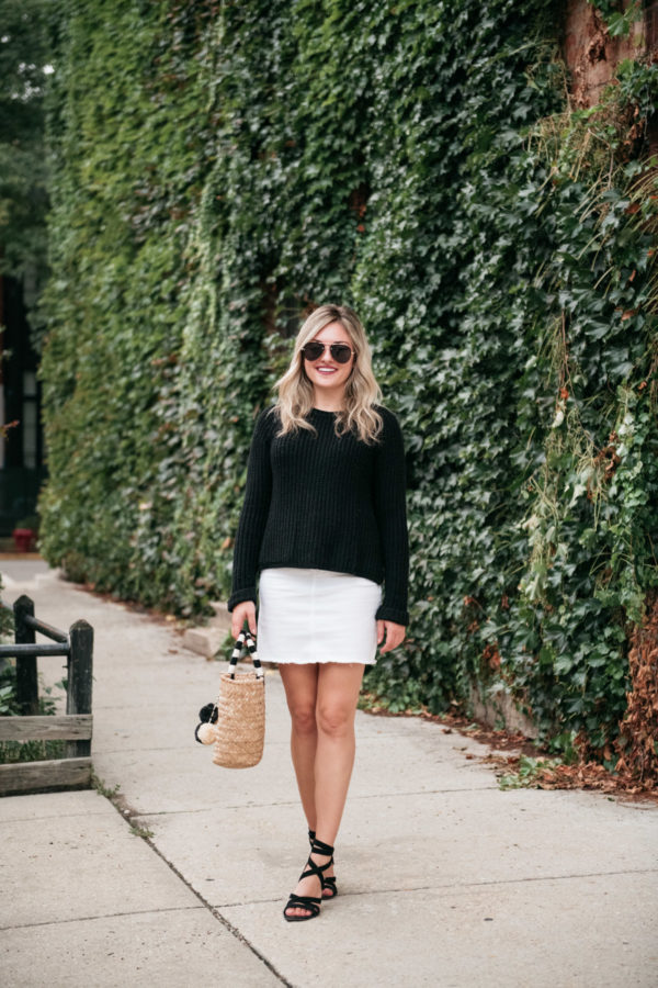 Chicago travel blogger Jessica Sturdy of Bows & Sequins wearing a black and white outfit that's perfect for the summer to fall transition.