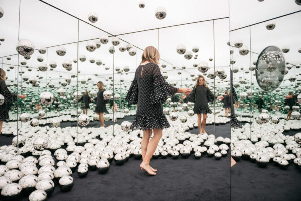 Chicago fashion blogger Jessica Sturdy at Yayoi Kusama's Infinity Mirrors exhibit at the wndr museum in Chicago.