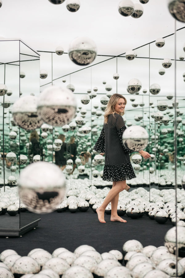 Chicago-based female travel blogger Jessica Sturdy of Bows & Sequins in the Infinity Mirrors room at the wndr museum.