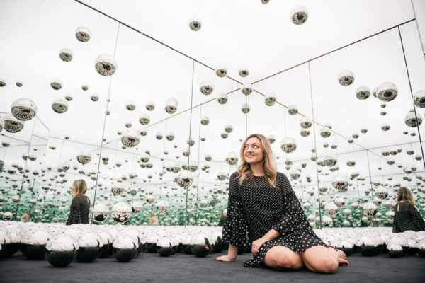 Women's travel lifestyle blogger Jessica Sturdy of Bows & Sequins at the wndr museum in Chicago.