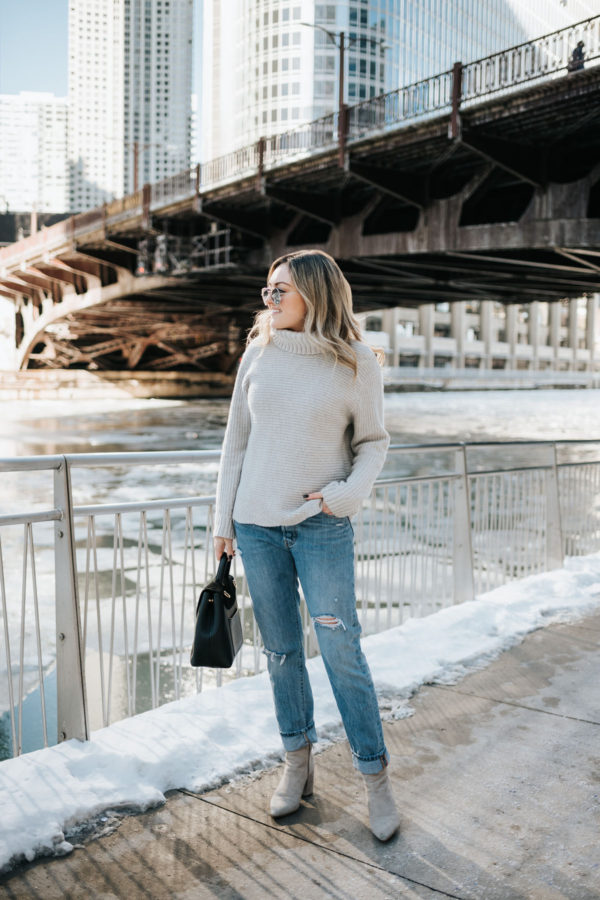Chicago fashion blogger Jessica Sturdy of Bows & Sequins wearing a grey turtleneck sweater, boyfriend jeans, and booties.