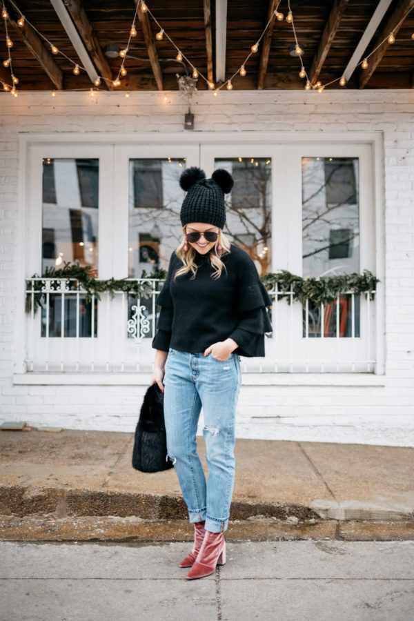 Fashion blogger Jessica Sturdy of Bows & Sequins wearing a double pom pom beanie.