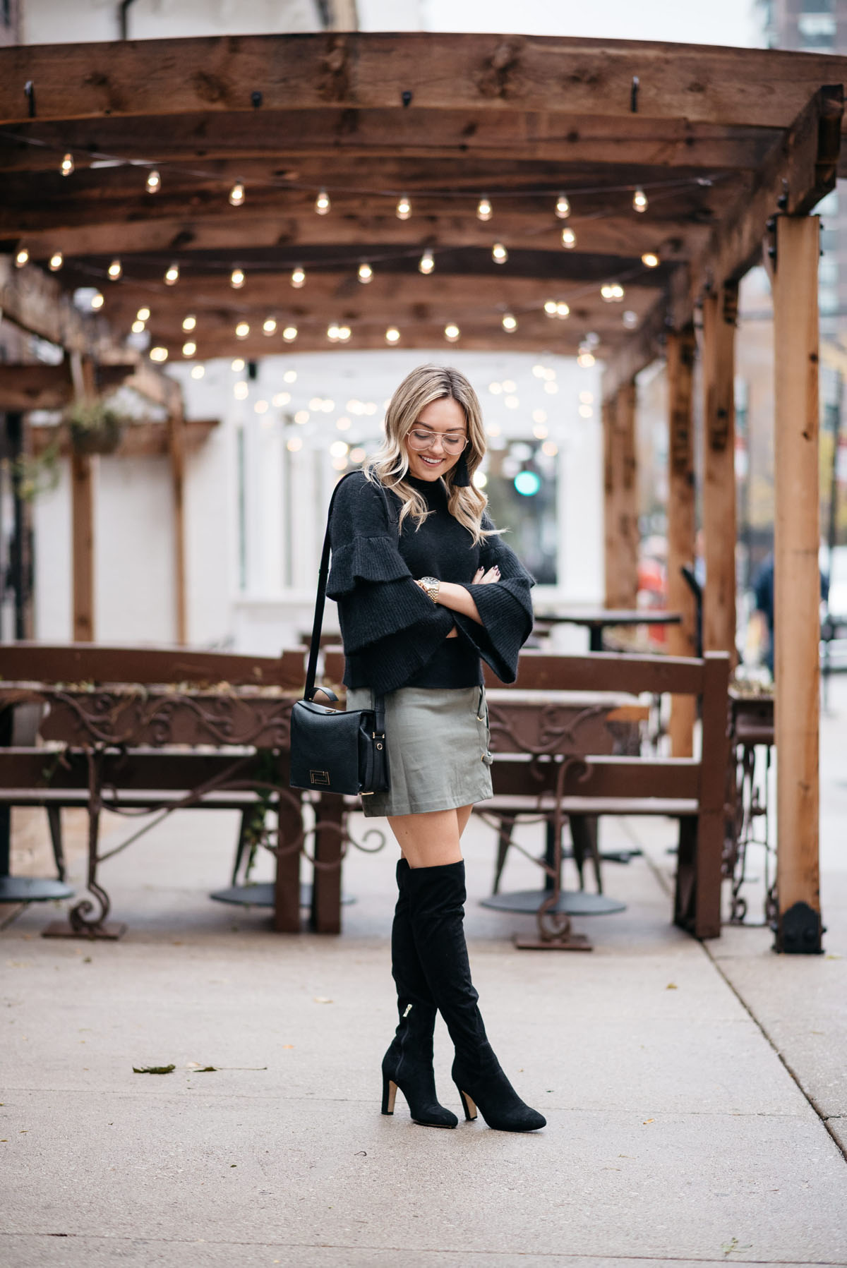a75899b2cf8 Chicago lifestyle influencer Jessica Sturdy of Bows   Sequins wearing a  black ruffled sleeve sweater with. Thanksgiving Outfit ...